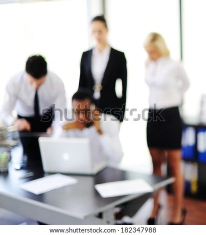 Business people working in office (note: image is out of focus) - stock photo