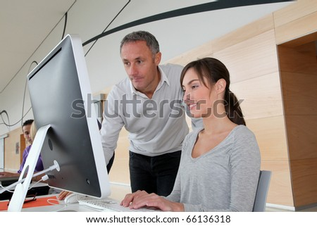 Business people working in the office on computer - stock photo