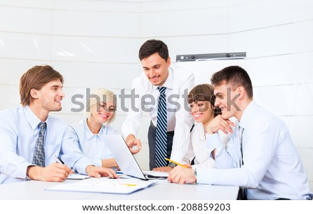 business people working looking to laptop screen, discussion on meeting, group businesspeople smile, team cooperation sitting at desk in office, communicate