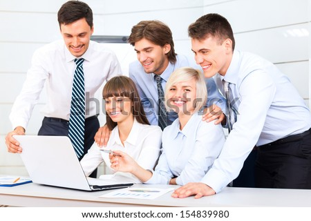 business people working looking to laptop screen, discussion on meeting, happy group businesspeople smile, team cooperation sitting at desk in office, communicate - stock photo