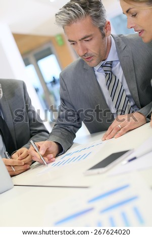 Business people working on budget strategy - stock photo