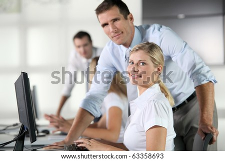 Business people working on computer - stock photo