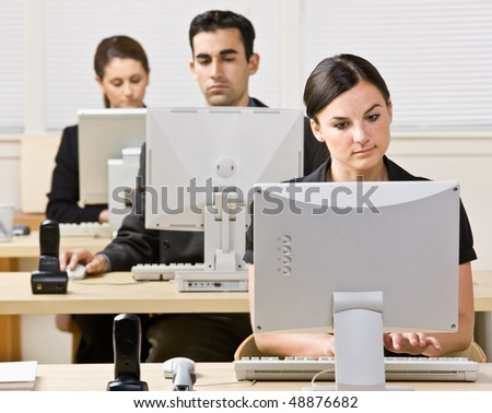 Business people working on computers - stock photo