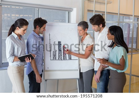 Business people working on graph for presentation in the office - stock photo