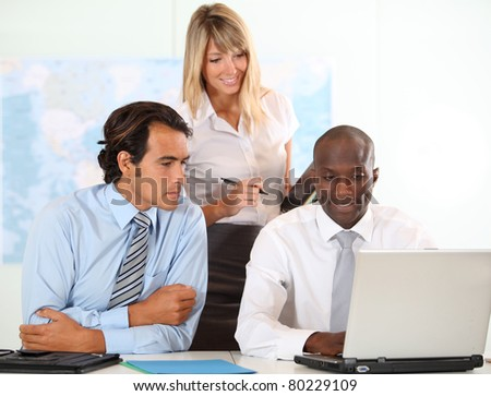 Business people working on international project - stock photo
