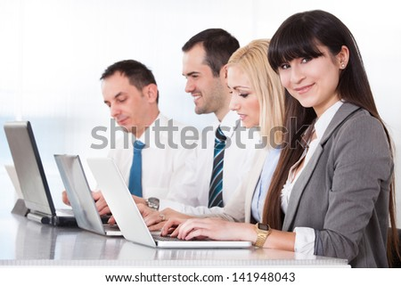 Business People Working On Laptop In Office