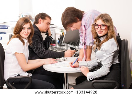 Business people working on project in office