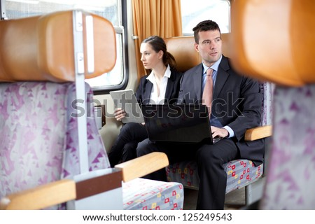 Business people working on the train