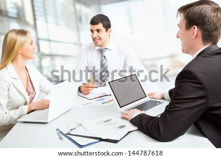 Business people working on their business project together at office - stock photo