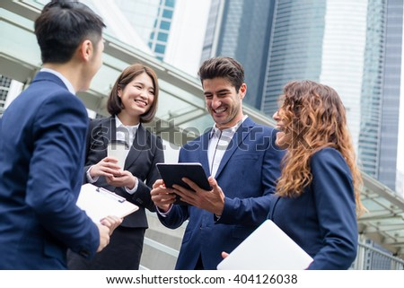 Business people working outside office - stock photo
