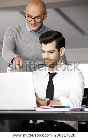 Business people working together and analyzing financial data on computer. Teamwork. - stock photo