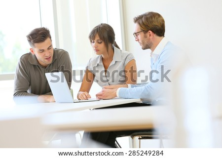 Business people working together in meeting room - stock photo