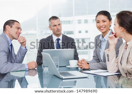 Business people working together over coffee in bright office - stock photo