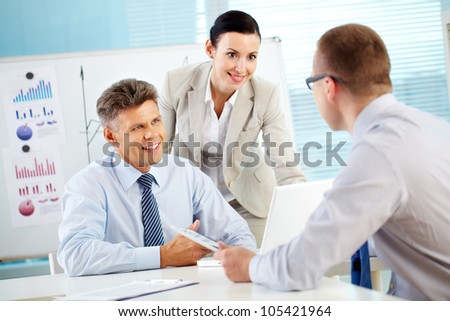 Business people working together to achieve better results - stock photo