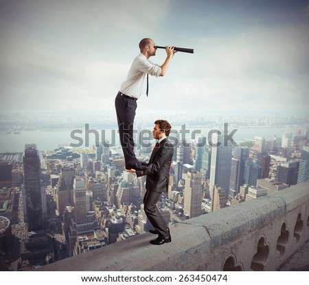 Business people working together to look beyond - stock photo