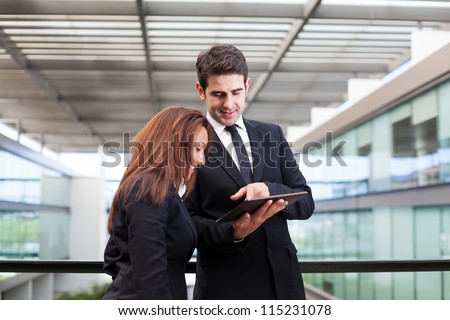Business people working with electronic tablet - stock photo