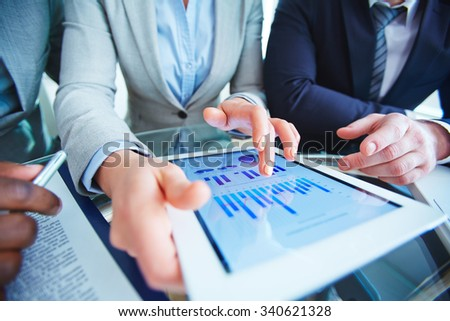 Business people working with graphs and charts