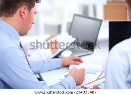 Business people working with laptop in an office, sitting ta the desk