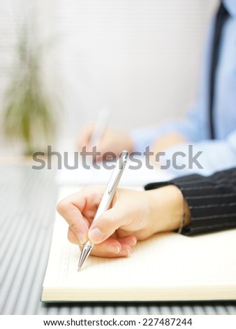 Business people writing notes  sitting in the office