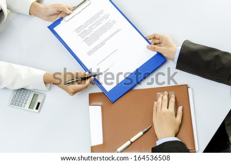 Business person about to sign contract - stock photo
