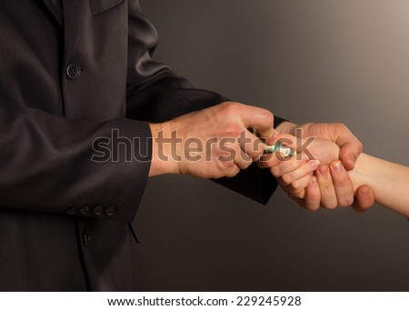 business person accepting a bribe, on a black background