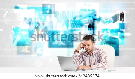 Business person at desk with modern blue tech images at background - stock photo