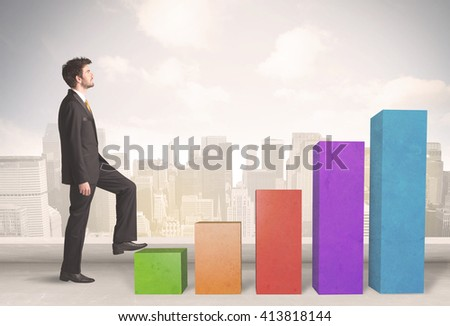 Business person climbing up on colourful chart pillars concept on city background - stock photo