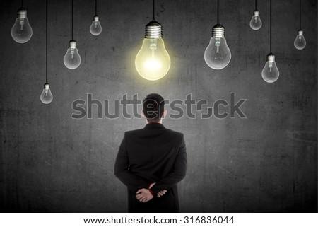 Business person having a bright idea light bulb concept. Business creative conceptual - stock photo