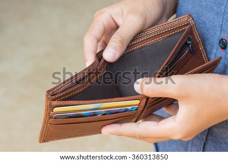 business person holding an empty wallet - stock photo