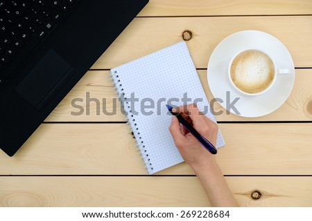 Business person holding pen   - stock photo