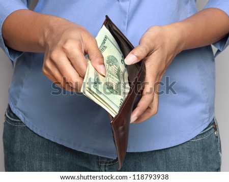 business person holding wallet with money - stock photo