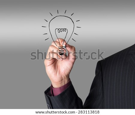 Business person in black suit making a motivational presentation - concept idea for idea, invention and creativity - stock photo