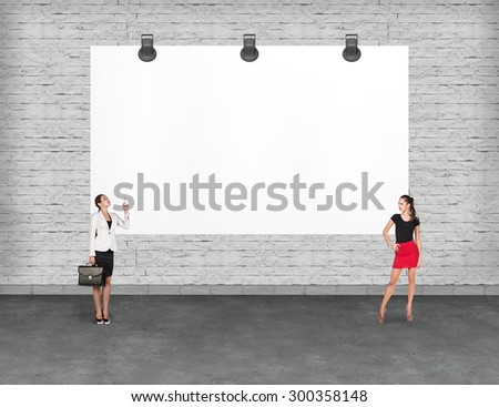 Business person in office suit standing near a blank  billboard  - stock photo