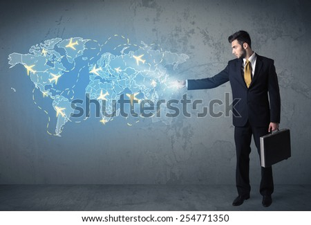 Business person showing digital blue map with planes around the world concept - stock photo