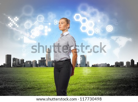 Business person standing against modern virtual technology background - stock photo