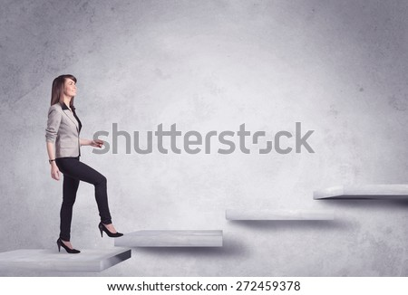 Business person stepping up a staircase - stock photo