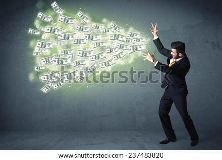 Business person throwing a lot of dollar bills concept on background - stock photo