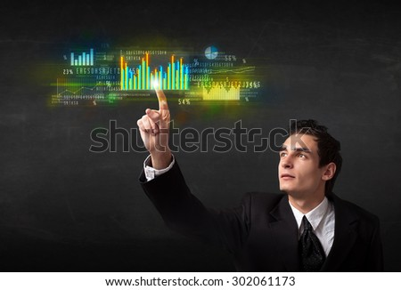Business person touching colorful charts and diagrams