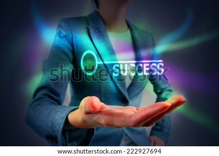 Business person touching key success - stock photo
