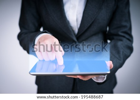 business person touching screen of tablet PC