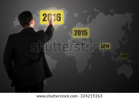 Business person touching 2016 year button on virtual business concept