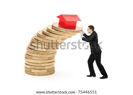 Business person trying to stop the real estate prices from falling - stock photo
