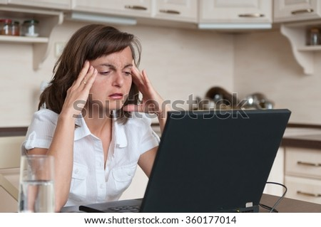 Business person with headache in work - stock photo