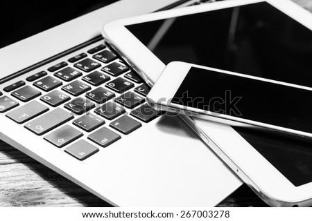 Business, phone, laptop. - stock photo