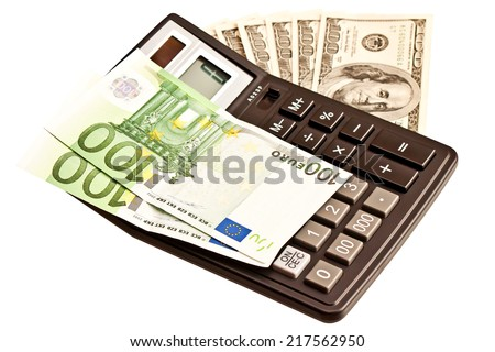 Business picture: money and calculator over white  - stock photo