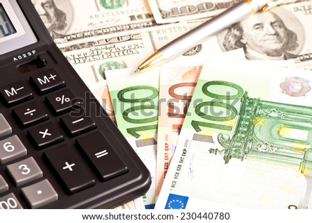 Business picture: money, pen and calculator over white  - stock photo
