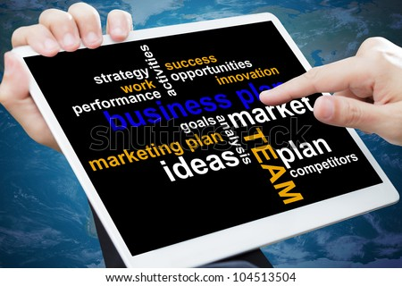 Business plan chart on a touch screen tablet - stock photo
