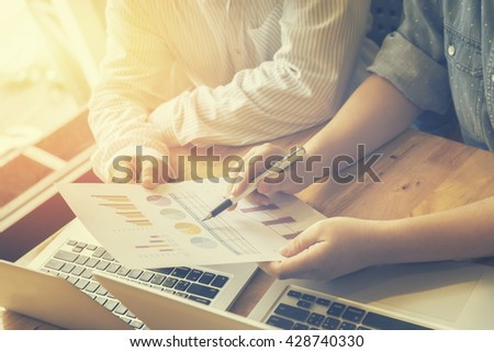 Business plan,Team work process.Business people discussing the charts and graphs showing the results of their successful teamwork,Analyze business plan,success business,selective focus,vintage color - stock photo