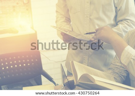 Business plan,Team work process.Businessman hand pointing at document in touchpad during explanation of data at meeting.Analyze business plan,success business,selective focus,vintage color - stock photo