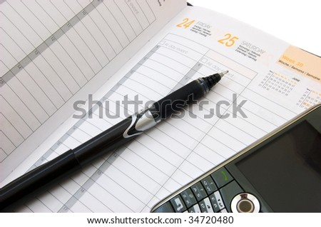 Business planner showing the end of the week with a pen and a smart phone - stock photo